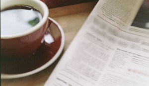 Coffee and newspaper for reading roundup post